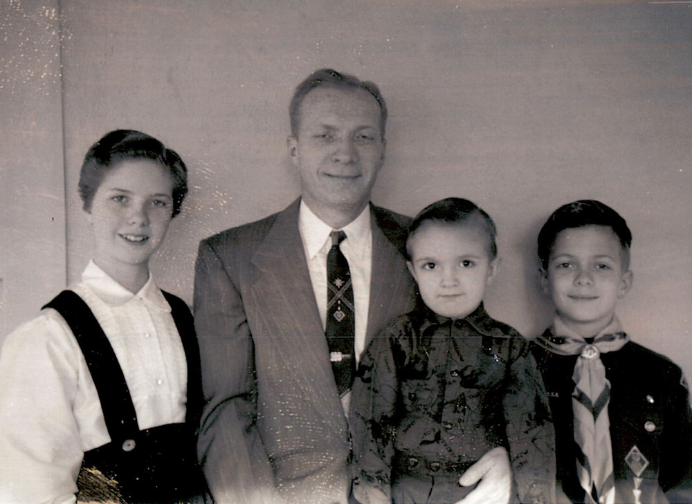Young Jack Smith with sister, father, and brother in 1954