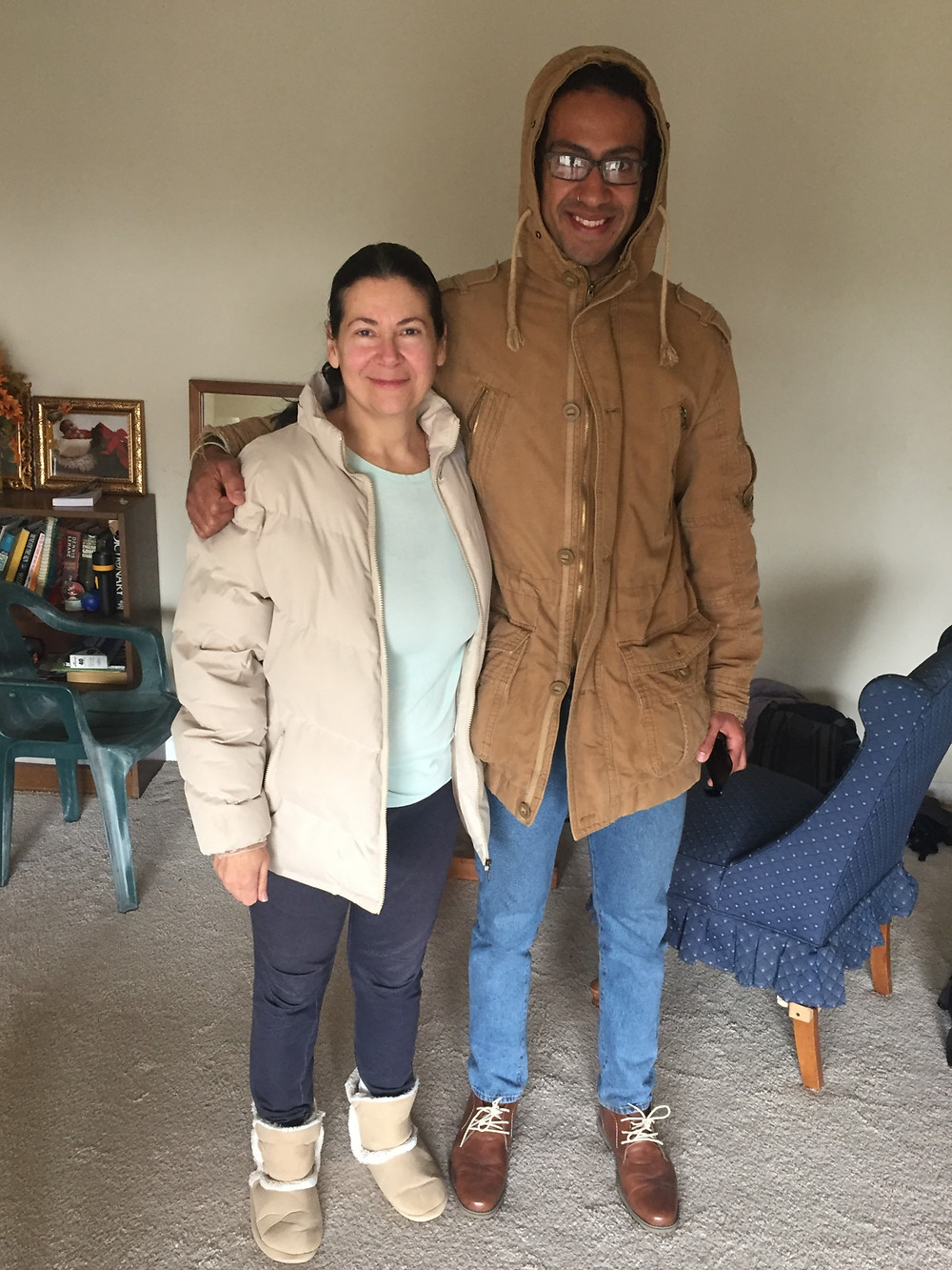 adult son and mom in living room