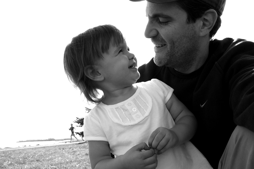 Dadvocacy Consulting Group Director of Communications Scott Beller and young daughter smiling