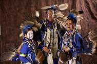 Dadvocacy Consulting Group Dadvisor Kel Rainer with children in Native American ceremonial dress