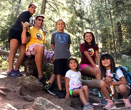 Dadvocacy Consulting Group Dadvisor Doctor Anthony Fleg with wife and four children outdoors hiking