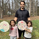Dadvocacy Consulting Group Dadvisor,Iraq War veteran, and Armor Down founder Ben King and his two daughters showing artwork