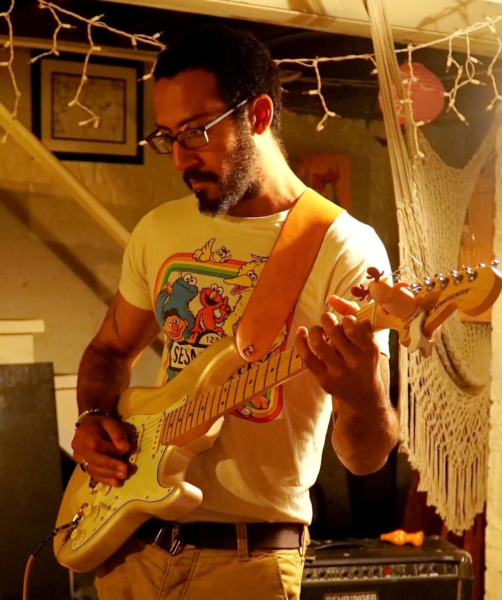musician plays guitar