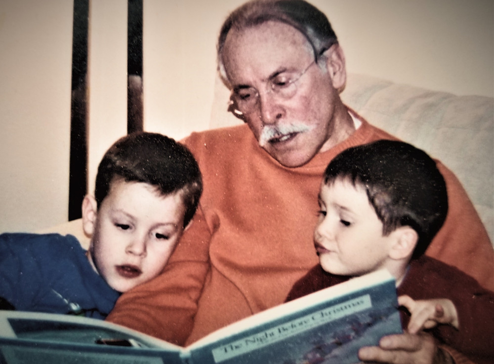 DCG Founder Allan Shedlin reads to his grandsons on Christmas Eve