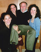 Dadvocacy Consulting Group founder Allan Shedlin being carried by his three adult daughters