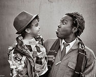 Dadvocacy Consulting Group Dadvisor and Albuquerque NM poet laureate Hakim Bellamy with son