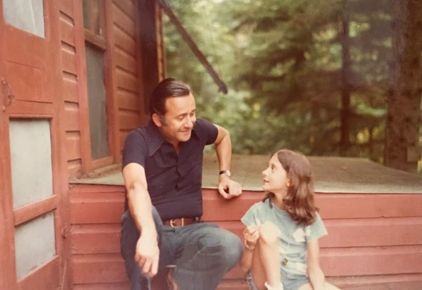 dad and daughter sitting on porch