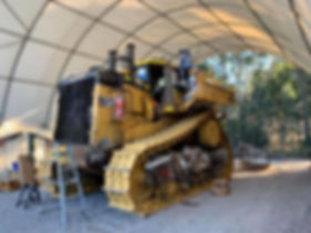 Industrial, Construction CAT excavator before being abrasive blasted and painted