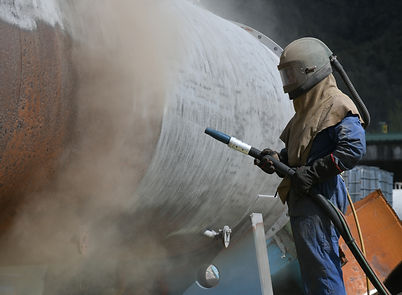 Sandblasting & Abrasive blasting on a industrial site equipment to remove rust