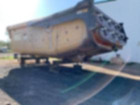 Abrasive blasting on heavy equipment before image.JPG
