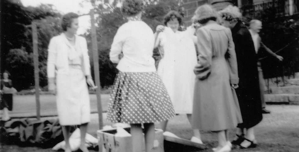 Selling Used Clothes at Fete, 1960s