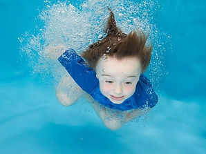 Young child swimming underwater