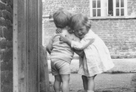Two children outside 32 High Street
