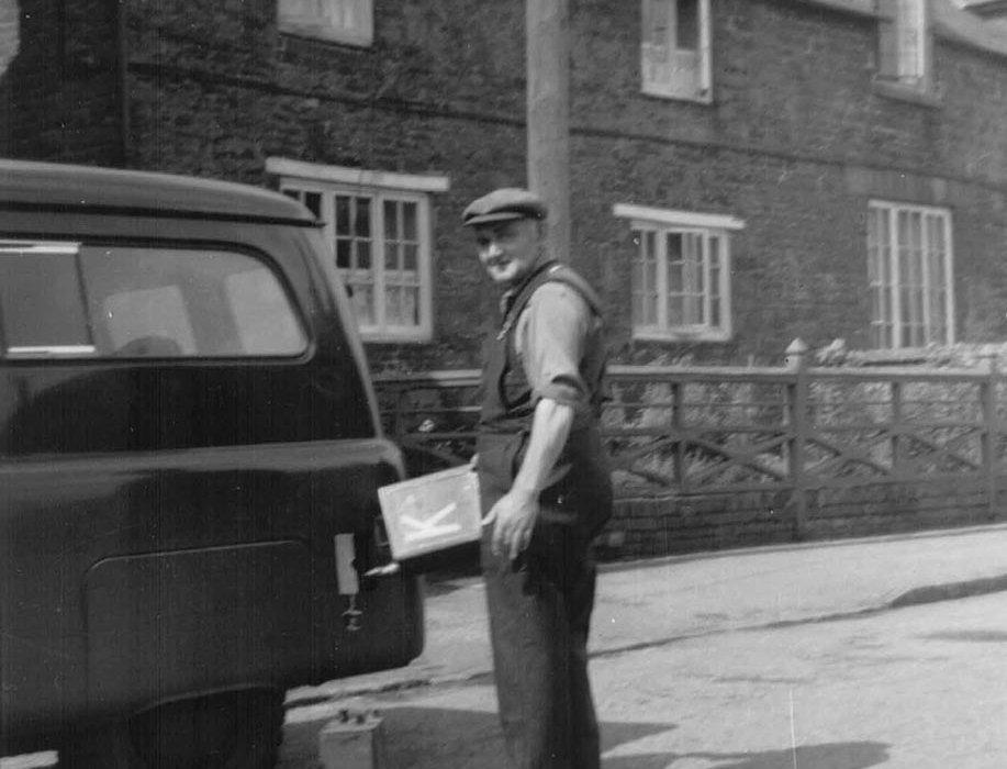 Eric Walker filling a Thomas Kench van post war