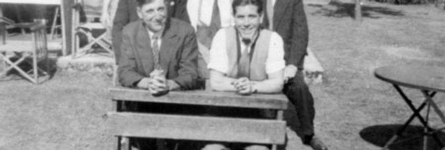 Group of Men in School Desk