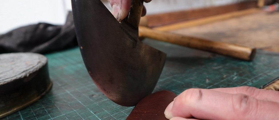 Trimming the belt point with saddlers knife.