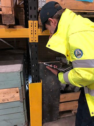 SEMA inspector assessing damage to a rack frame.