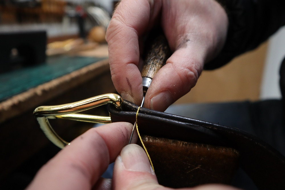 We hand-sew with a saddlers needle and awl.