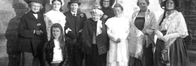 The WI in costume outside the Village Hall, 1950s