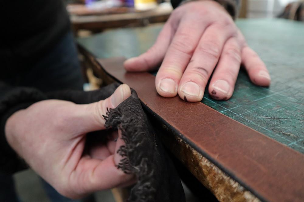 Hand polishing the belt edges