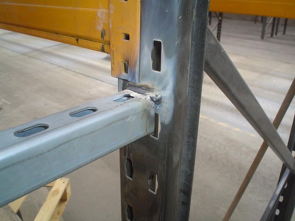 Clear signs of rewelding to pallet racking which is not acceptable