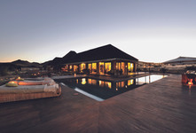 Enjoy the sunset by the Lodge pool