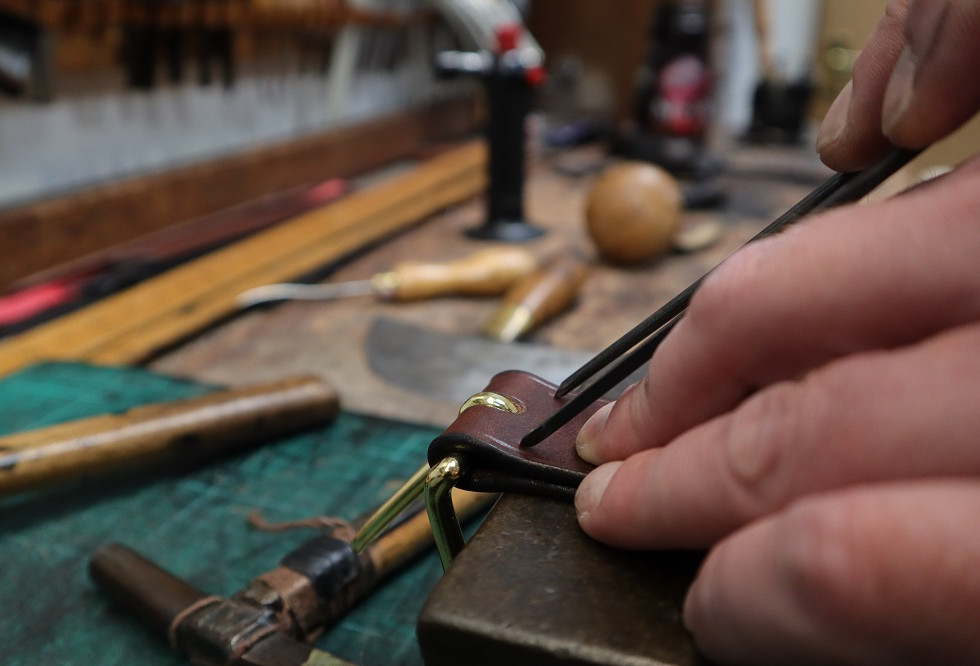 Marking the leather ready for stitching.