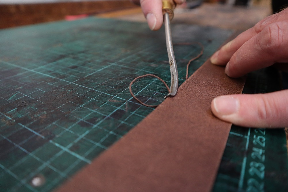 Removing the leather edges.
