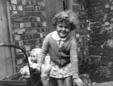 Ann Noble playing with her dolls