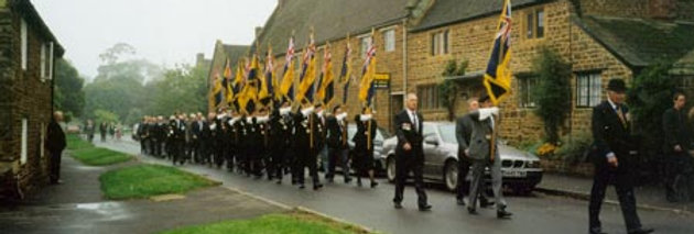 Standards of the Royal British Legion parade along High Street, 1998