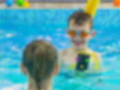 Young children swimmimg