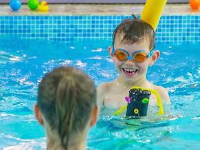 Young children swimmimg