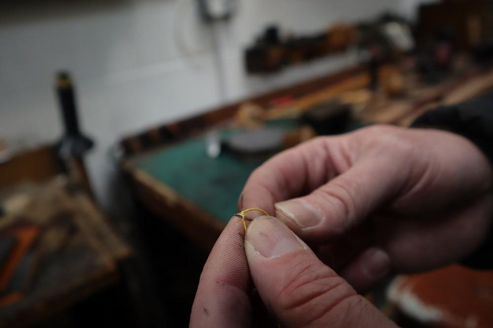 ...then thread the needle onto the thread.