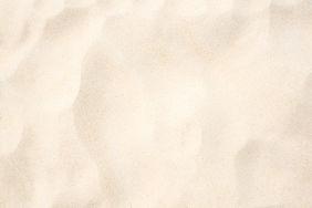 Sand on the beach as background.jpg