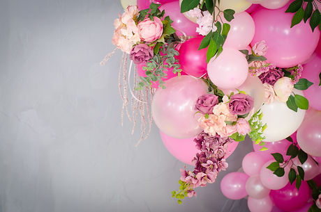 Pink balloons decorated with a bouquet o