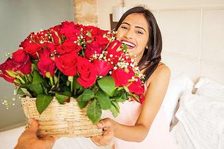 happy indian woman getting flowers deliv