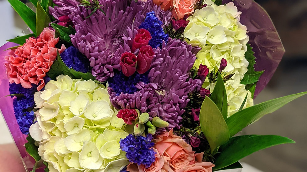 Mixed in season sleeved bouquet