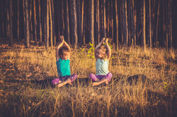 Little girls practicing yoga