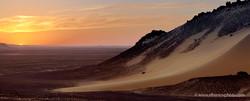 Sunset in the black desert