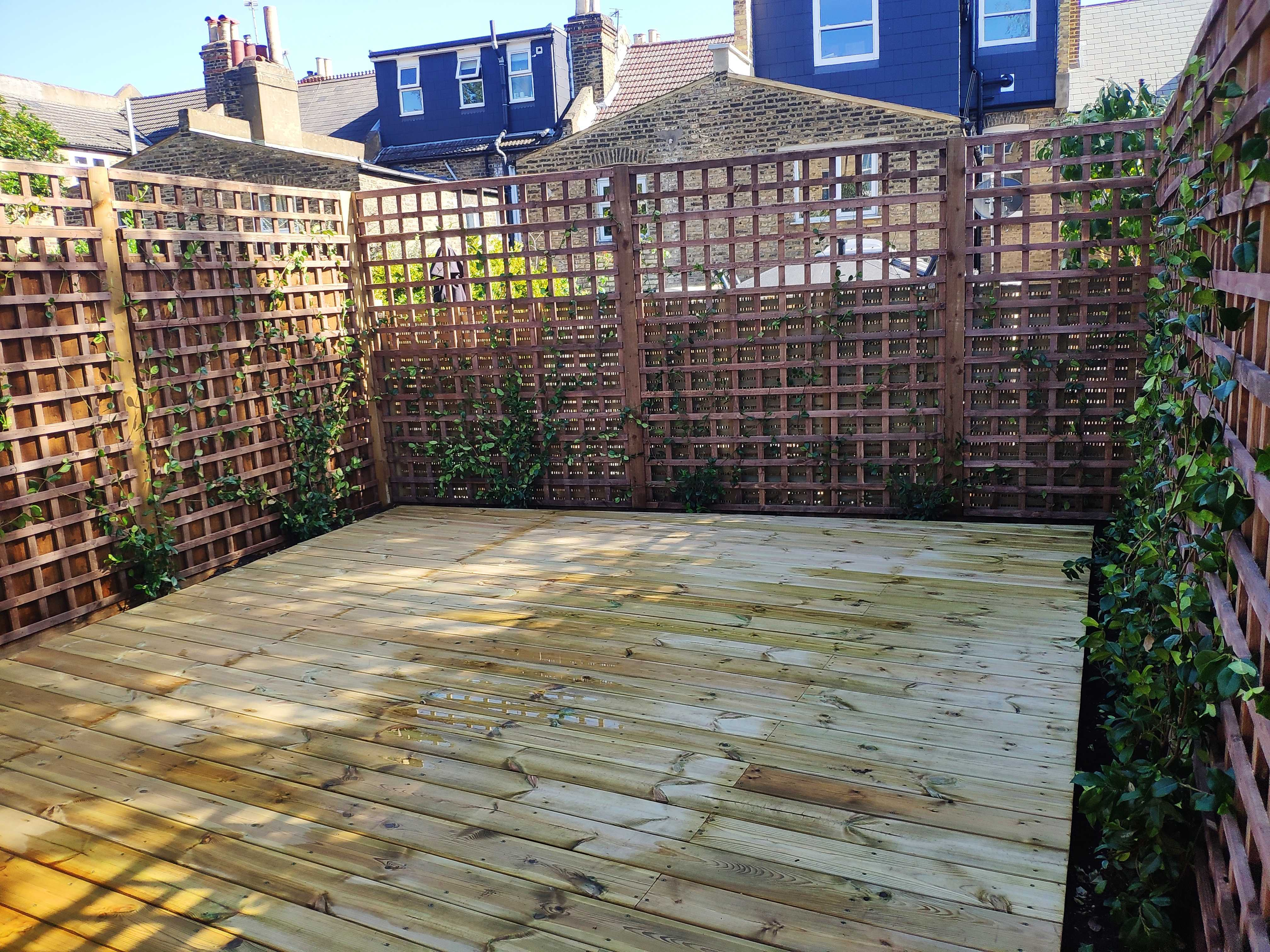 softwood decking with trellis around