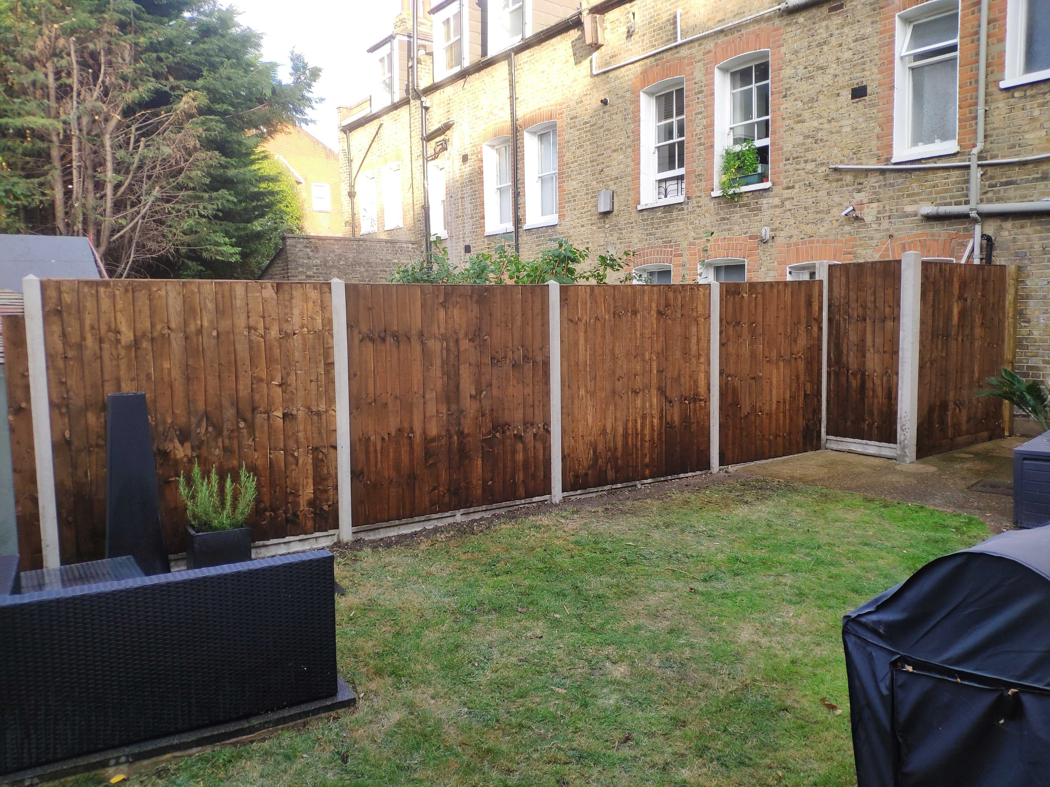 concrete and closeboard fence