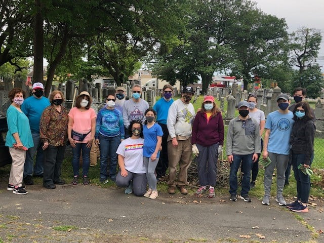 A group of volunteers from Temple Beth Sholom pose after helping clean up the Jewish sections of New Camden Cemetery and flagging Jewish war veterans' graves.