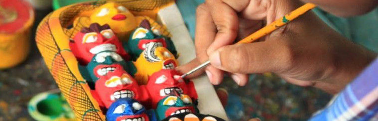 Painting-masks-at-a-mask-making-workshop