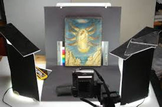 Light studio of painting being photographed