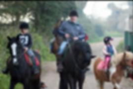 Henry Smith horse trekking with family at Corballis farm in Donabate Dublin Ireland