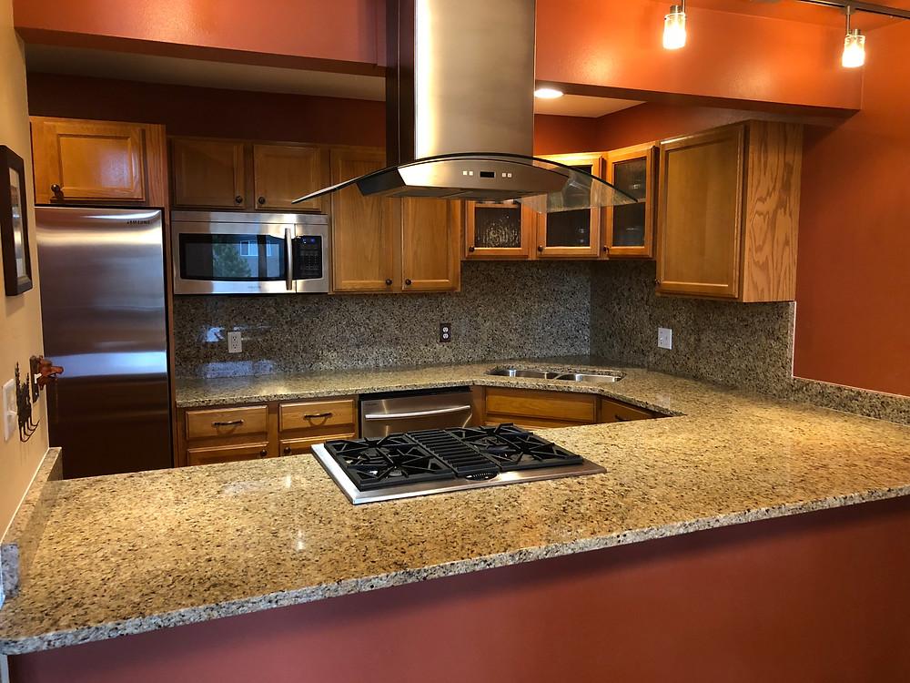 Kitchen countertops installed with new Venetian gold from granite liquidators In Denver, co