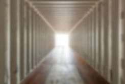 Inside an empty shipping container cente
