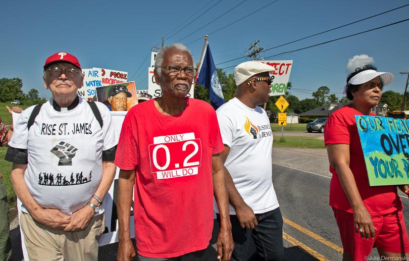 Robert Taylor leading a march in St. John the Baptist Parish.