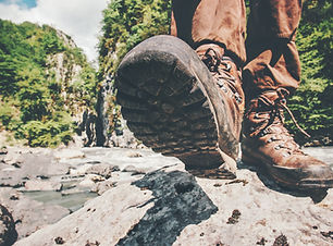 Feet trekking boots hiking Traveler alone outdoor wild nature Lifestyle Travel extreme sur