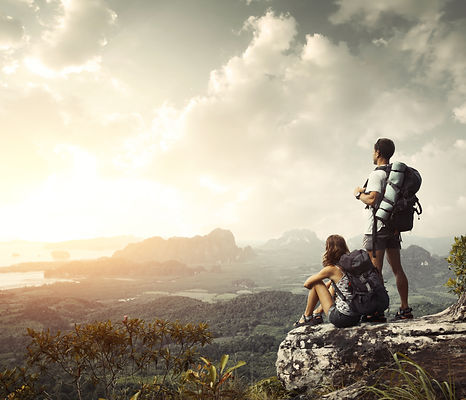 Hikers with backpacks enjoying valley vi